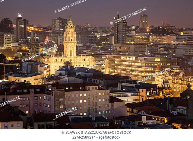 Porto city hall seen from Torre dos Clerigos at night. Portugal