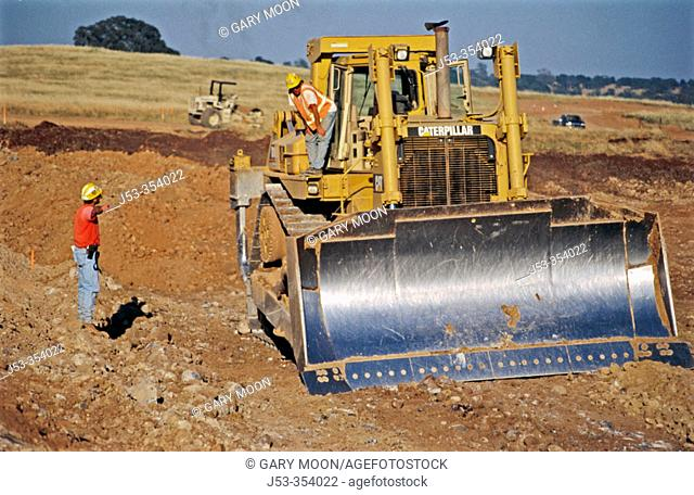 Foreman checking excavating project. Lincoln. California. USA