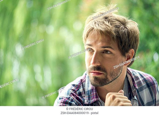 Man looking away in thought, portrait