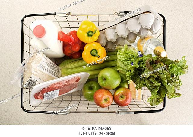 Overhead view of groceries in basket