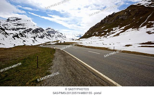 Road in the snowy valley in winter, St. Moritz, Italy