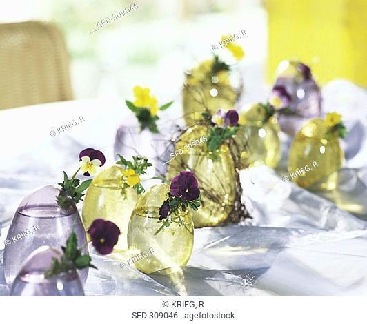 Glass Easter egg vases with horned violets & pansies