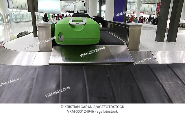 Baggage arrives at the baggage claim area of Chek Lap Kok International Airport, Hong Kong, China, East Asia