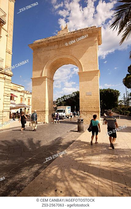 Tourists near the Porta Reale gate at Largo Porta Nazionale sqauare, Noto, Sicily, Italy, Europe