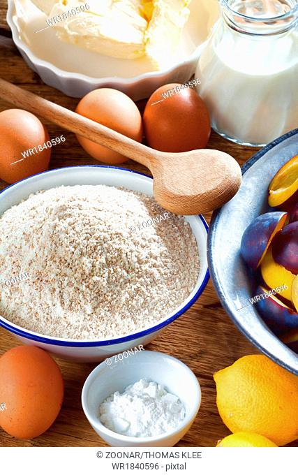 Background of the ingredients for a plum cake