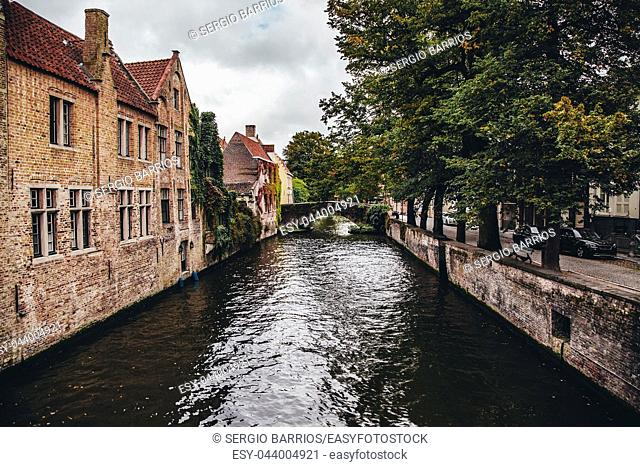 Medieval channels of Bruges, detail of tourism in a city of Belgium