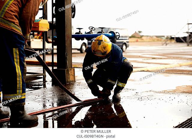 Firemen training, checking fire hose