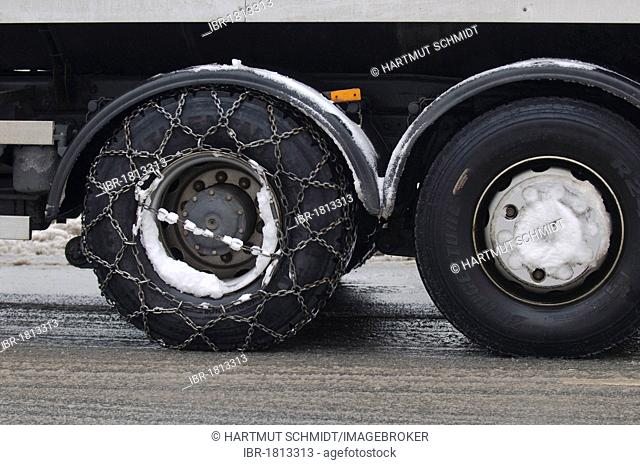 Winter, truck with snow chains on the drive axle
