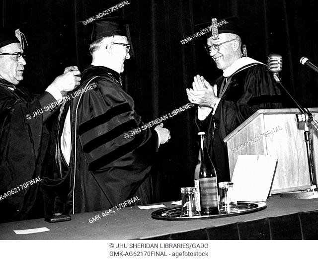 Bologna Center, SAIS, Milton Stover Eisenhower, Eisenhower applauding after awarding diploma at ceremony marking 10th anniversary of Bologna Center, 1965