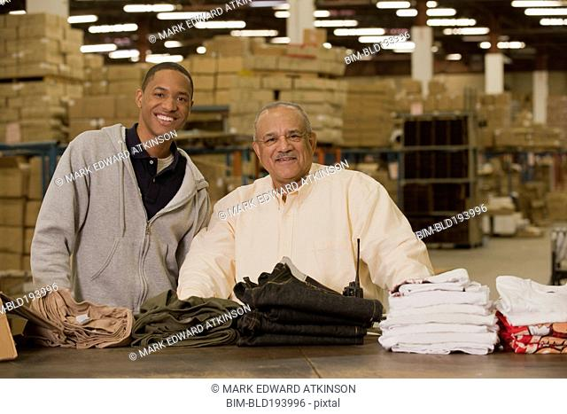 Manager standing with worker in warehouse