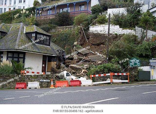 Landslip with van crushed under debris in coastal town, Quay Road, Looe, Cornwall, England, October 2008