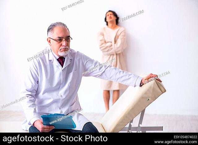 The aged male doctor psychiatrist examining young patient