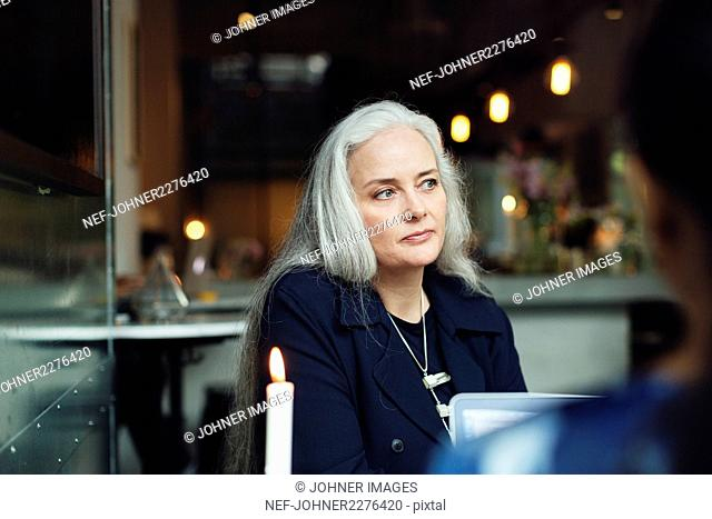 Portrait of woman sitting in cafe