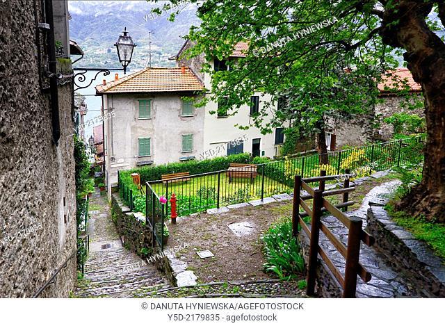 street scene in Corenno Plinio, Lake Como in the background , commune Dervio, Lombardy, Italy