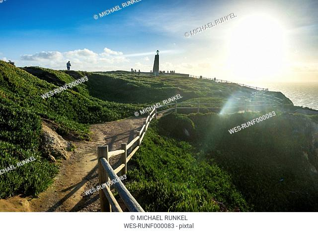 Portugal, Cabo da Roca, Backlight of a track leading to the monument of Europe's most western point