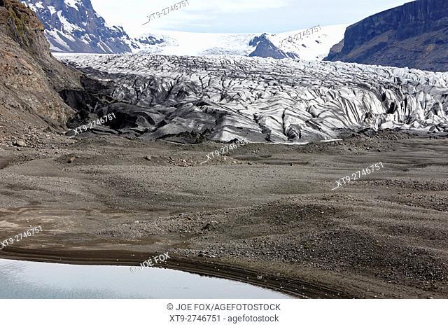 ash covered Skaftafell glacier and end moraine Vatnajokull national park in Iceland