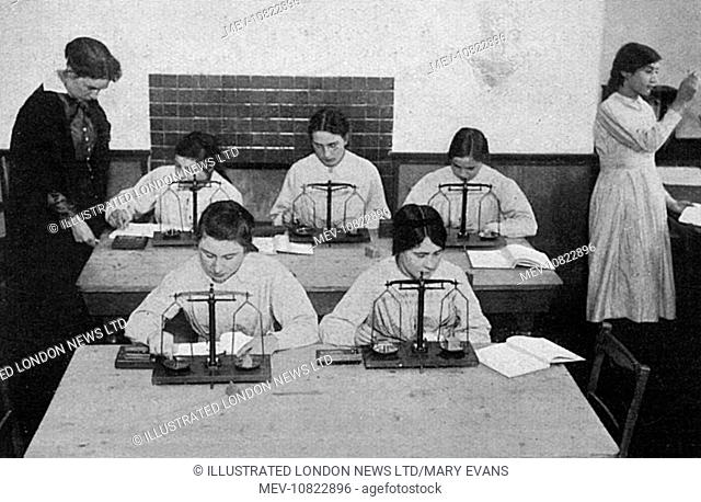 Women at a London County Council school in Hammersmith, training in chemistry following the acceptance of women dispensers by the Army medical authorities...