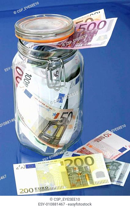 bank notes in a glass jar