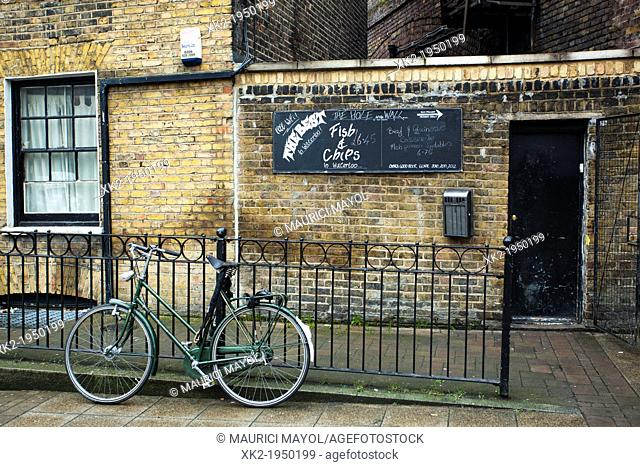 Bike parked in front of a Fish and Chips, near waterloo, London, UK