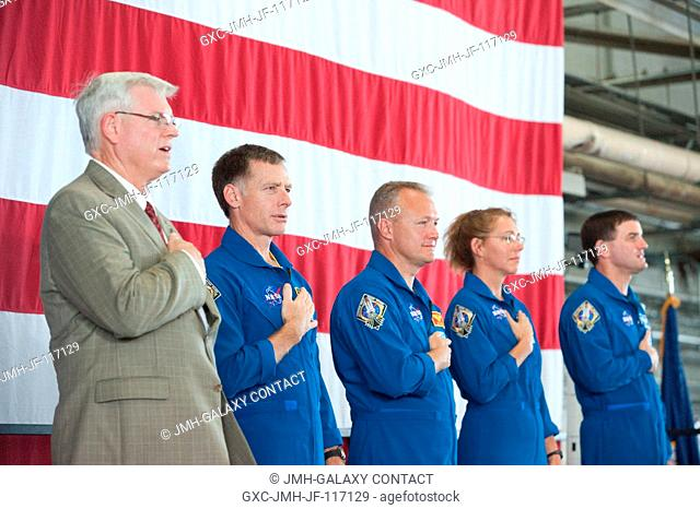 NASA's Johnson Space Center (JSC) director Michael L. Coats (left) and STS-135 crew members are pictured during the STS-135 crew return ceremony on July 22
