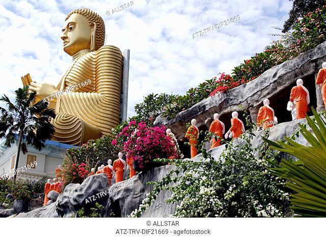 LINE OF MONKS & BIG BUDDHA AT THE GOLDEN TEMPLE; DAMBULLA, SRI LANKA; 08/03/2013