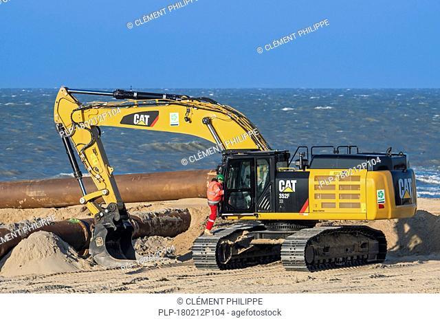 Caterpillar 352F XE, hydraulic excavator used by Dredging International / DEME for sand replenishment / beach nourishment along the North Sea coast