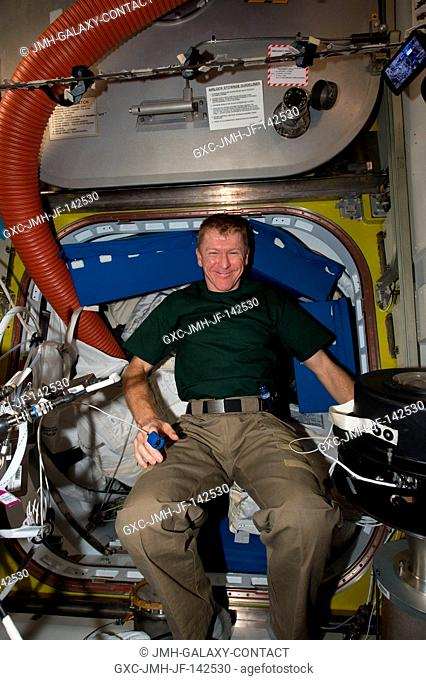 ESA (European Space Agency) astronaut Timothy Peake participates in the Airway Monitoring experiment. With dust particles present in the International Space...
