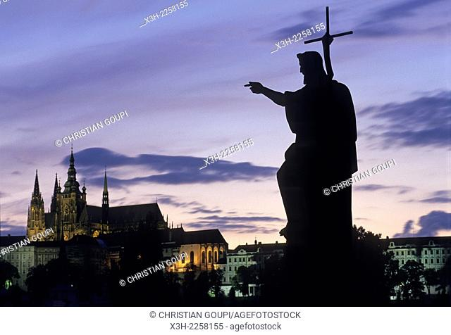 statues on the Charles Bridge at dusk with the Castle and the Cathedral St-Guy in the background, Prague, Czech Republic, Europe