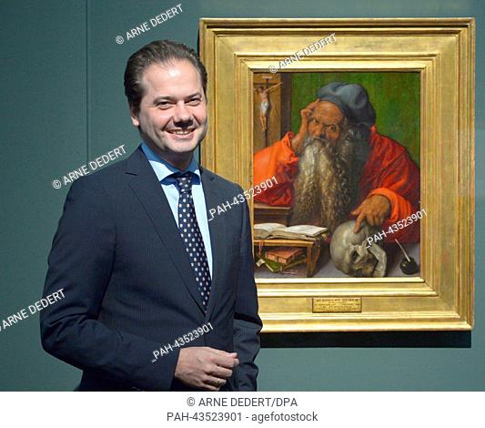 "Staedel director Max Hollein stands in front of the work A woman looks at the """"Saint Jerome in His Study"""" (1521) by Albrecht Duerer at the Staedel Museum in..."