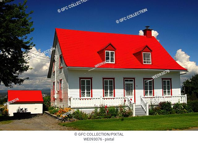 Family home with red roof on Orleans Island, Île d'Orléans, Province of Quebec, Canada