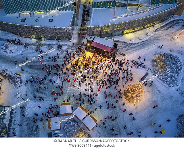 Top veiw of People gathering for a Christmas Celebration, Kopavogur, a suburb of Reykajvik, Iceland. This image is shot using a drone