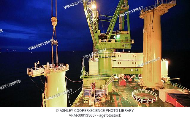 Constructing an off-shore windfarm at night