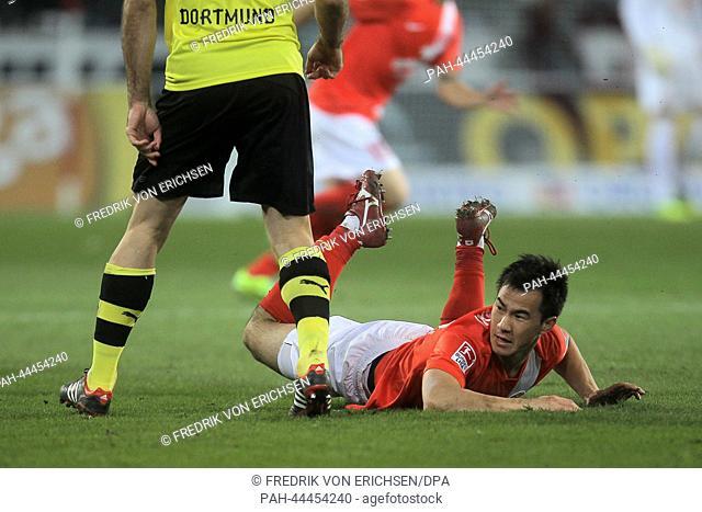 Mainz' Shinji Okazaki lies on the pitch during the German Bundesliga match between FSVMainz and Borussia Dortmund at Coface Arena in Mainz,Germany