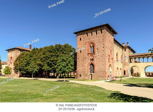 view of trees and buildings in courtyard at Renaissance castle of small town, shot in a bright summer day at Vigevano, Pavia, Lombardy, Italy