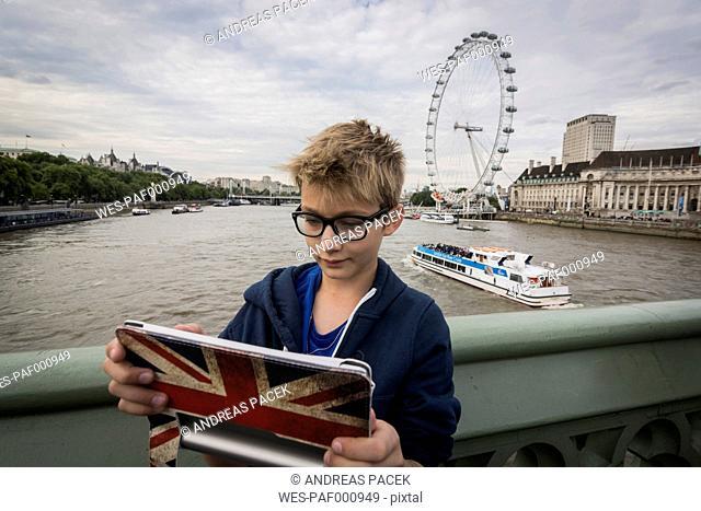 UK, London, boy taking a selfie with his digital tablet