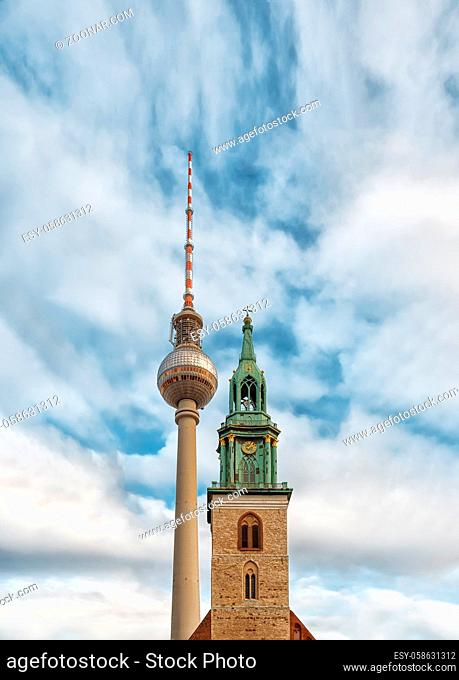 Berlin, Germany - December 9, 2019: Belltower of St. Mary's Church or Marienkirche. TV Tower near the Church. Located on Karl-Liebknecht-Strasse near...