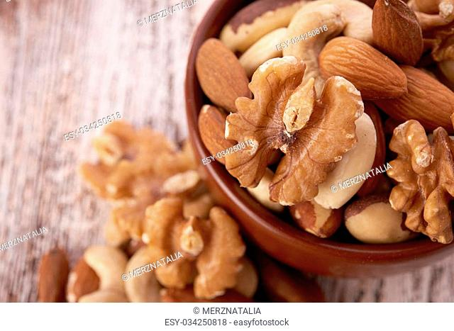 Mix nuts on wooden background