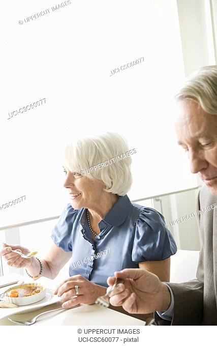 Senior couple eating at restaurant
