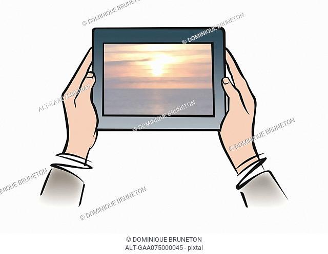 Illustration of hands holding digital tablet showing tranquil sunset