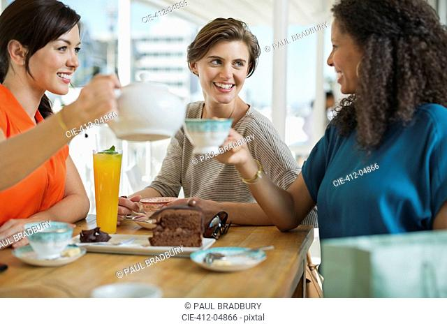 Women having coffee and cake together
