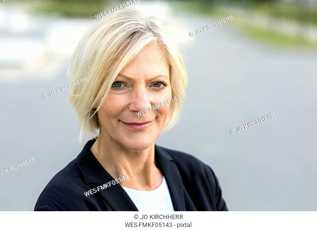 Portrait of confident senior businesswoman outdoors