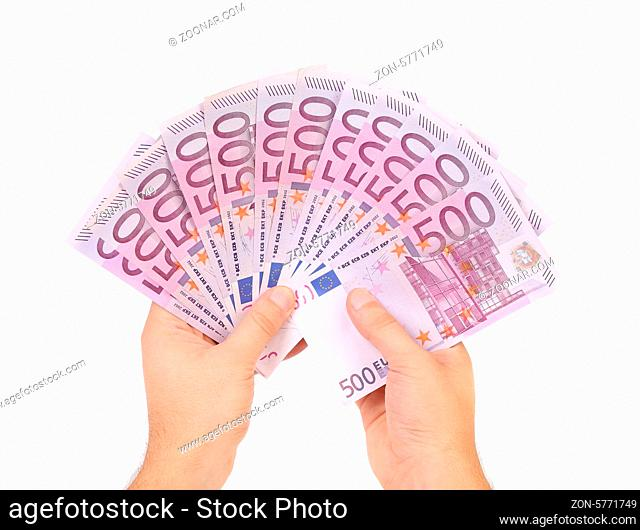 Hands holding 500 euros banknotes isolated on a white
