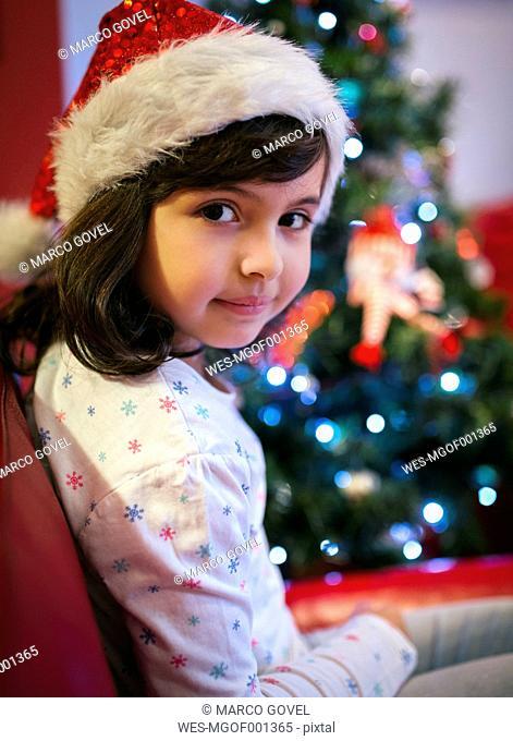 Portrait of smiling little girl wearing Christmas hat