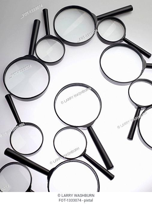 Magnifying glasses over white background