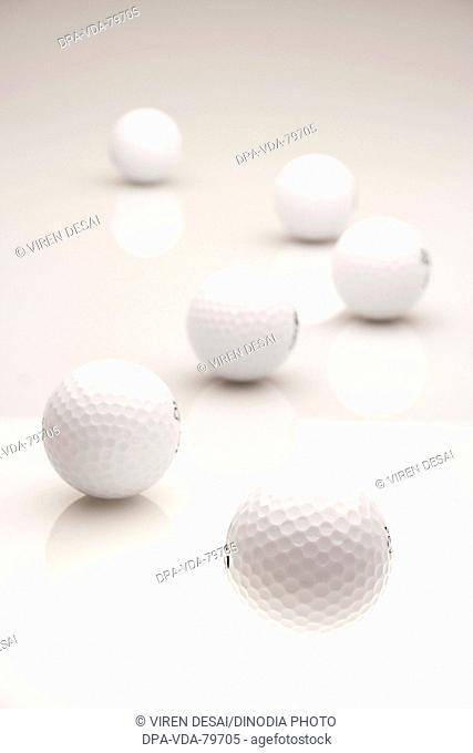 Golf balls six against white background