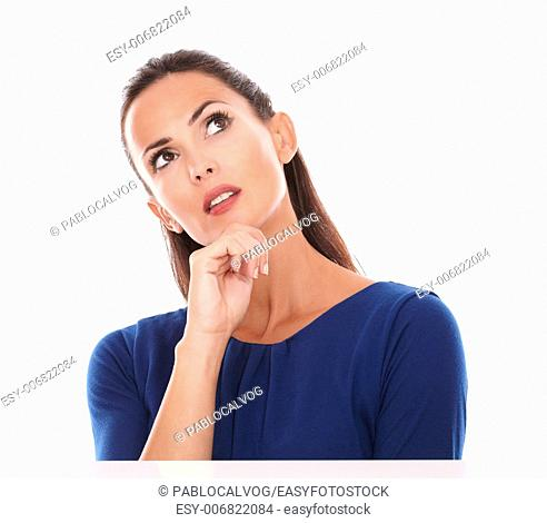 Woman in blue blouse looking up and feels reflective in white background - copyspace