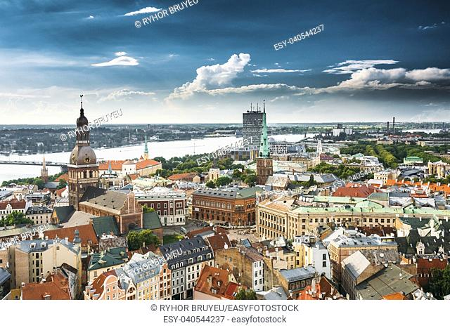 Riga, Latvia. Riga Cityscape In Sunny Summer Day. Famous Landmarks - Riga Dome Cathedral And St. James's Cathedral, or the Cathedral Basilica of St