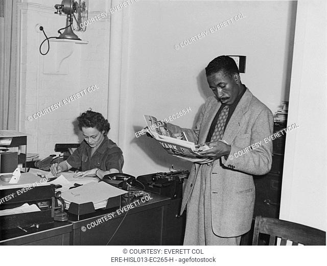 Gordon Parks 1912-1906 as a young photographer in the offices of the Farm Security Administration FSA after he won fellowship with to photograph for the FSA