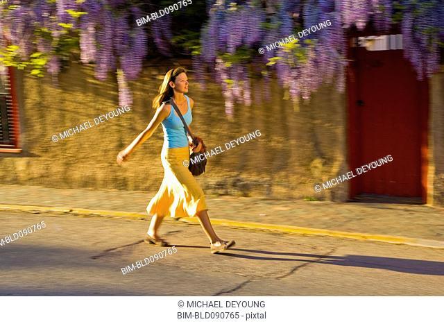 Caucasian woman walking on street