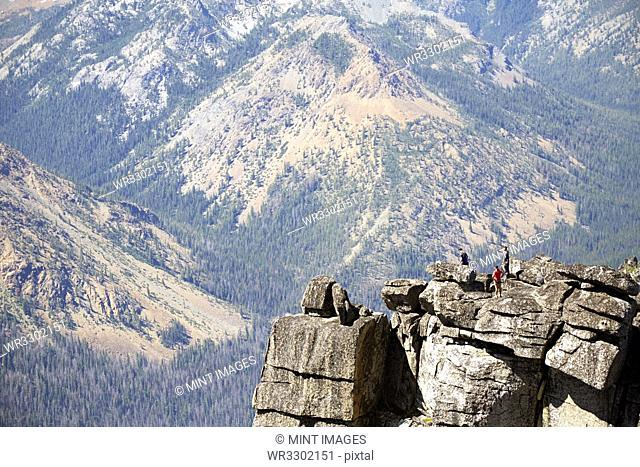 People hiking on rocky hilltop